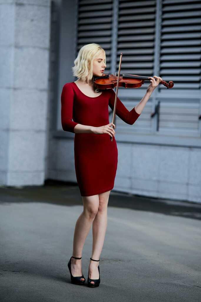 girl in short red dress (musician on street0, shot on canon 6D