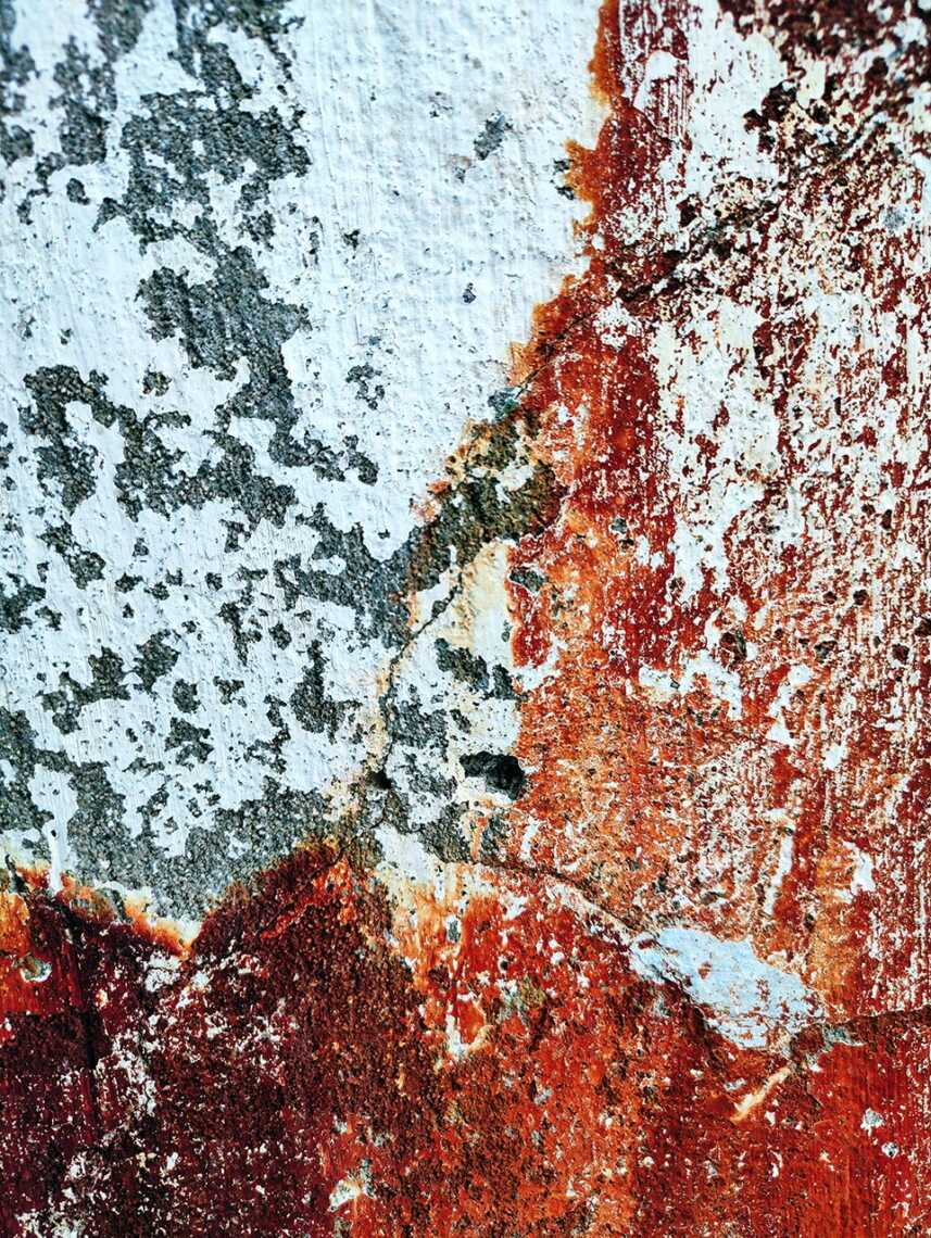 Rust on the white wall close-up. Semples of photos on Ultra 64 Mp camera smartphone Realme XT