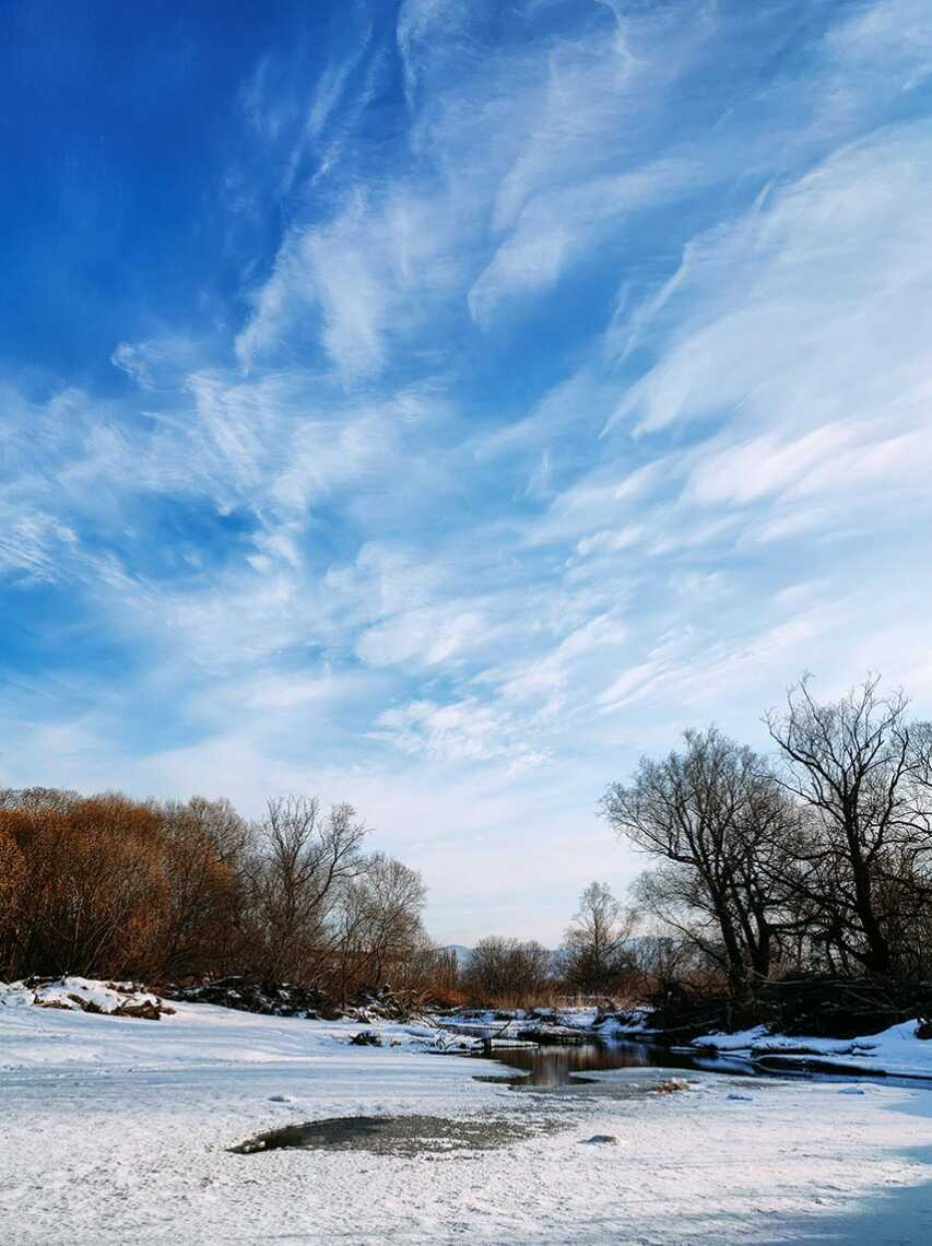 Winter landscape with river and clouds. 64 Megapixel photo - background for desktop for free download